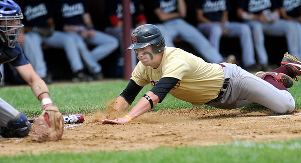 Parkersburg catcher Jordan Braniff, left, waits to put the tag on Beckley Post 32 Joey Lacek, right, during Saturday action at Woodrow Wilson. F. Brian Ferguson/The Register-Herald