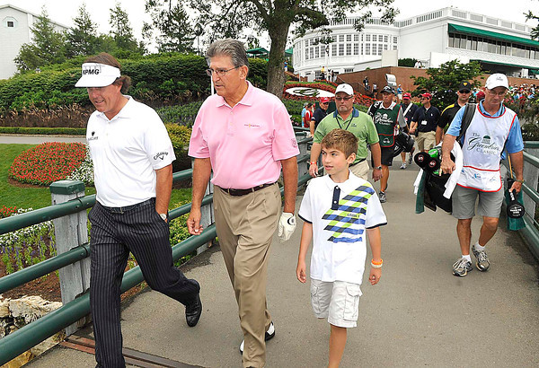 Phil Mickelson, left, US Senator Joe Manchin and Manchin's grandson Jack Bresch, 10, walking together on the first hole during The Greenbrier Classic Pro-Am held on the Old White course Wednesday afternoon.<br /> Rick Barbero/The Register-Herald