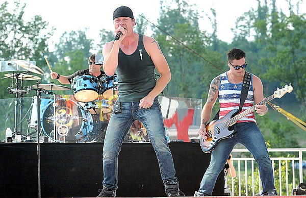 Lead singer Brad Arnold, center, of 3 Doors Down, perform for scouts during the National Boy Scout Jamboree Saturday evening at the new Summit Bechtel Family National Scout Reserve near Glen Jean, WV<br /> Rick Barbero/The Register-Herald