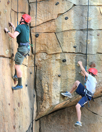 Michael Williams, Troop C221, of Ashville, N.C., left, and Noel Witt, troop D208, of State College, Pa. rock climb during the Boy Scout Jamboree Friday morning at the new Summit Bechtel Family National Scout Reserve near Glen Jean, WV<br /> Rick Barbero/The Register-Herald