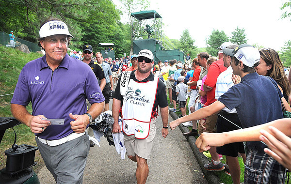Phil Mickelson finished up on the 9th hole during the second round of The Greenbrier Classic Friday on the Old White TPC Course at The Greenbrier Resort in White Sulphur Springs.<br /> Rick Barbero/The Register-Herald