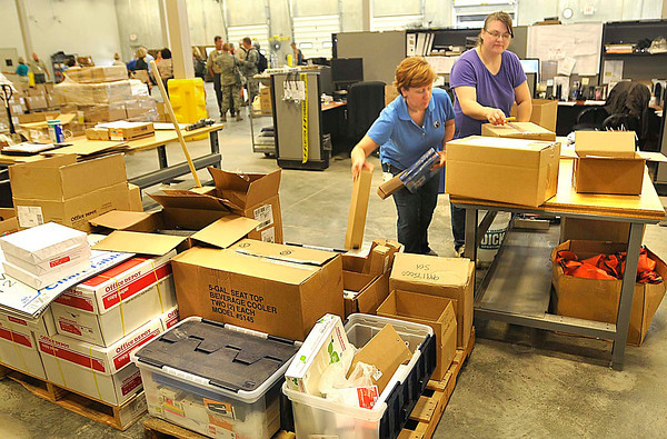 Brenda Howells, floor supervisor, left, and Robin Guill, stock picker, package up some supplies in the Edward H. & Jeanne Logistics Center Wednesday afternoon at the new Summit Bechtel Family National Scout Reserve in Mt. Hope, WV<br /> Rick Barbero/The Register-Herald
