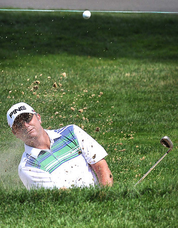 Bill Lunde hits from the trap on the 9th hole during the third round of The Greenbrier Classic Saturday on the Old White TPC Course at The Greenbrier Resort in White Sulphur Springs.<br /> Rick Barbero/The Register-Herald