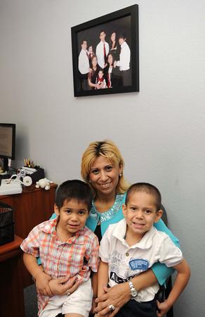 Christina Rhodes, CEO manager director Horizon Medical Health Center, holds her two grand children, Leonardo. left, and Christopher Herrera.<br /> Rick Barbero/The Register-Herald