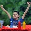 Dylan Leigh, 8, celebrates his third place in the Stewart Hotdog eating contest outside of Alderson on Thursday afternoon. F. Brian Ferguson/The Register-Herald