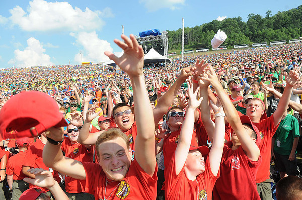 Scouts reach for a shirt that was launched before the 3 Doors concert during the National Boy Scout Jamboree Saturday evening at the new Summit Bechtel Family National Scout Reserve near Glen Jean, WV<br /> Rick Barbero/The Register-Herald