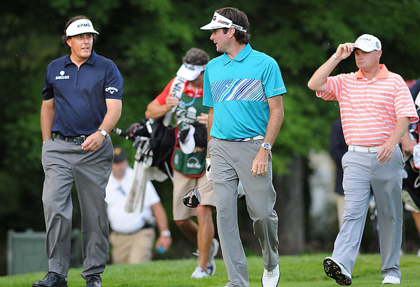 Phil Mickelson, left, Bubba Watson and Ted Potter Jr. walk together down the 12th fairway during the first round of The Greenbrier Classic Thursday on the Old White TPC Course at The Greenbrier Resort in White Sulphur Springs.<br /> Rick Barbero/The Register-Herald