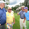 Jim Justice, owner and chairman The Greenbrier Resort, left, golf pro John Daly, Jeff Kmiec, president and managing director and John Klemish, broker in charge and advisor to the chairman, talk on the 4th tee box  during The Greenbrier Classic Pro-Am.<br /> Rick Barbero/The Register-Herald