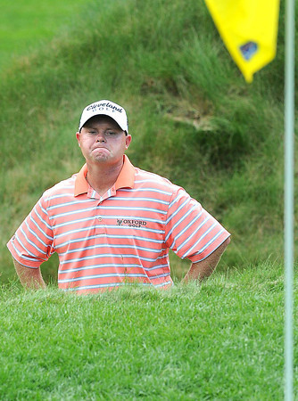 Ted Potter Jr. not liking the looks of his shot on the 8th hole during the first round of The Greenbrier Classic Thursday on the Old White TPC Course at The Greenbrier Resort in White Sulphur Springs.<br /> Rick Barbero/The Register-Herald