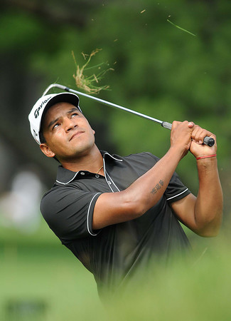 Fabian Gomez hits  shot from the rough on the 8th hole during the second round of The Greenbrier Classic Friday on the Old White TPC Course at The Greenbrier Resort in White Sulphur Springs.<br /> Rick Barbero/The Register-Herald