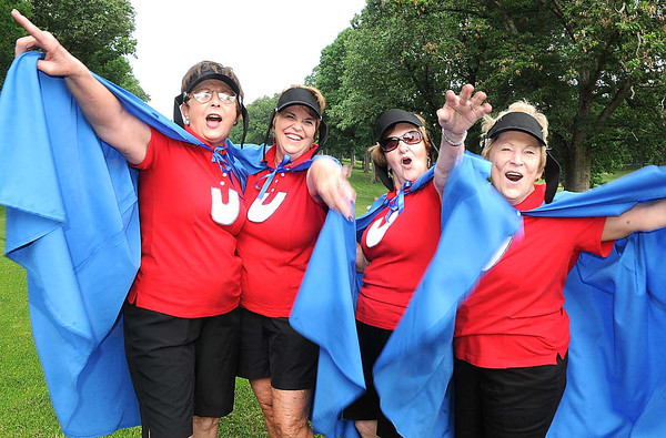 Judy Ragland, left, JoAnn Byron, Julia Mollohan and Ann Harkins, dressed up as the underdogs at Black Knight Country Club during the Tee Off with the Ladies fund raiser golf tournament for the United Way. <br /> Rick Barbero/The Register-Herald