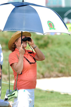 Suzanne Compilello, of Virginia Beach, Va. watches play on the 17th hole during the third round of The Greenbrier Classic Saturday on the Old White TPC Course at The Greenbrier Resort in White Sulphur Springs.<br /> Rick Barbero/The Register-Herald
