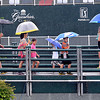 Heavy rains did not dampen the spirits of golf fans as they crossed the walking bridge on tee #1, on the Old White course, during Monday's practice rounds of the Geenbrier Classic. F. Brian Ferguson/The Register-Herald.