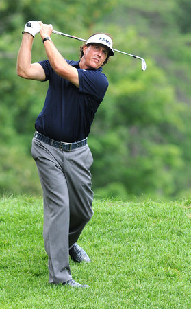 Phil Mickelson hitting from the rough on the 6th hole during first round of The Greenbrier Classic Thursday on the Old White TPC Course at The Greenbrier Resort in White Sulphur Springs.<br /> Rick Barbero/The Register-Herald