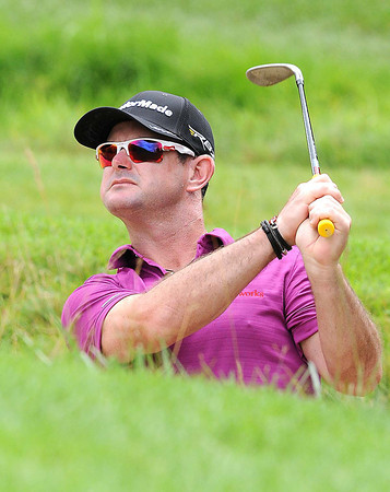 Roy Sabbatini holed his shot from the sand trap on the par 5 12th hole for eagle during the first round of The Greenbrier Classic Thursday on the Old White TPC Course at The Greenbrier Resort in White Sulphur Springs.<br /> Rick Barbero/The Register-Herald