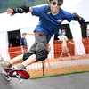 Aidan Halpin, troop B338, of North Carolina, skate boards during the  National Boy Scout Jamboree Monday morning at the new Summit Bechtel Family National Scout Reserve near Glen Jean, WV<br /> Rick Barbero/The Register-Herald