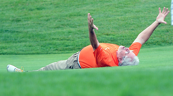 Edward Robinson, of Charleston, WV, celebrates on the #10 green after making a long chip shot during Thursday's Greenbrier Classic Pro-Am event. Robinson was paired with golf pro William McGirt. F. Brian Ferguson/The Register-Herald