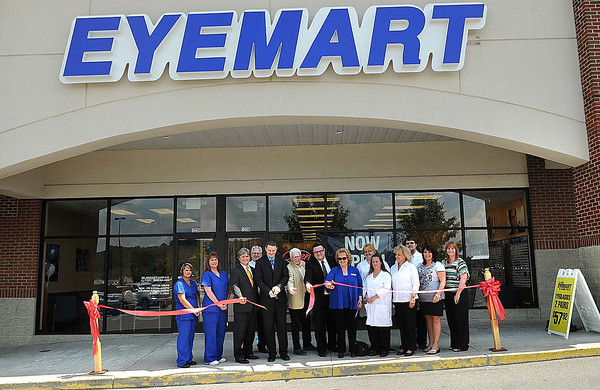 Eyemart Express Grand Opening Ribbon Cutting. Cutting ribbon third from left, Victor Flanagan, President Board of Directors Raleigh County Chamber or Commerce, Dr. Wesley Carr, Marty Finley, district manager, Patrick Bowling, gereral manager and Ellen Taylor, president CEO Raleigh County Chamber of Commerce.<br /> Rick Barbero/The Register-Herald