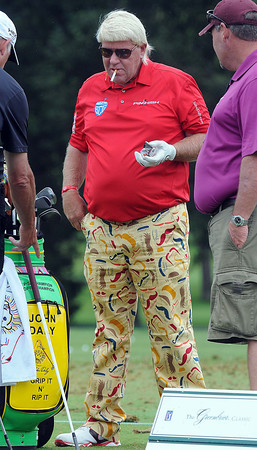 John Daly takes time out of his game during Monday's practice rounds of the Geenbrier Classic. F. Brian Ferguson/The Register-Herald.