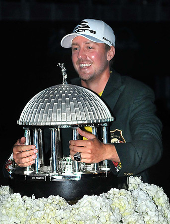 Jonas Blixt hugs the trophy after winning The Greenbrier Classic Sunday on the Old White TPC Course at The Greenbrier Resort in White Sulphur Springs.<br /> Rick Barbero/The Register-Herald