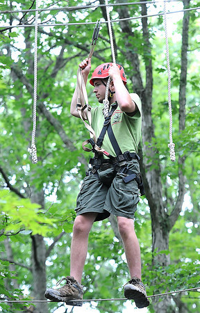 Caleb Rollins, troop A318, of Texas, on the rope challenge course during the National Boy Scout Jamboree Monday morning at the new Summit Bechtel Family National Scout Reserve near Glen Jean, WV<br /> Rick Barbero/The Register-Herald