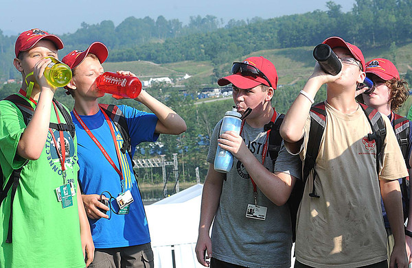 Ethen Bachand, left, Nicholas Abrams, Kyle Lang and Brian Daly, troop D234 from Connecticut, take a water break heading to there next adventure during the National Scout Jamboree at the new Summit Bechtel Family National Scout Reserve in Mt. Hope, WV<br /> Rick Barbero/The Register-Herald
