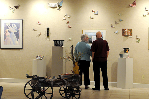"""Guests enjoyed Friday's Opening of the Beckley Art Group's """"Book Theme"""" exhibit.. F. Brian Ferguson/The Register-Herald"""