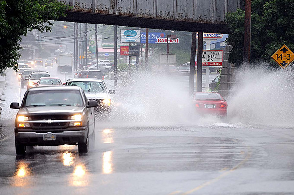 High water on Robert C Byrd Drive in Beckley Tuesday morning.<br /> Rick Barbero/The register-Herald