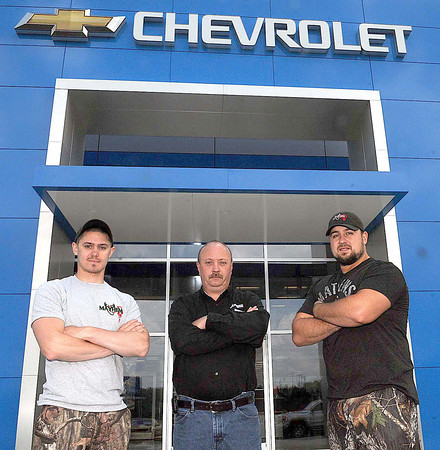 The cast of Mayham joined employees of Crossroads Chevy to film a commercial on Wednesday afternoon. (From left) Cast member Eric Boothe, Crossroads Chevy Manager Kenny Payne, and cast member Richard Stephenson.  F. Brian Ferguson/The Register-Herald