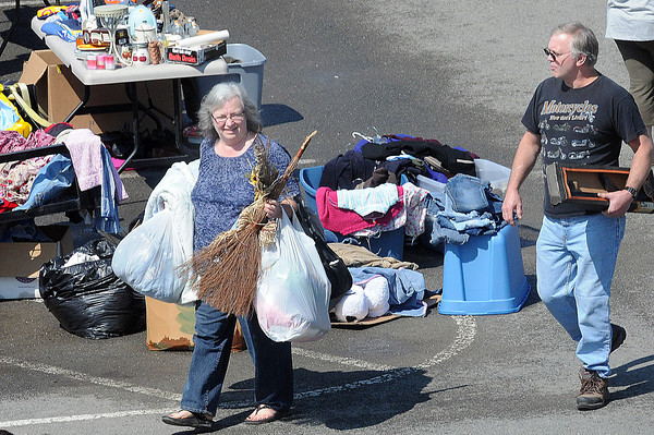 Not many shopper left with their hands free during Saturday's  NIE Auction and Flee Market at the Beckley Galleria. F. Brian Ferguson/The Register-Herald