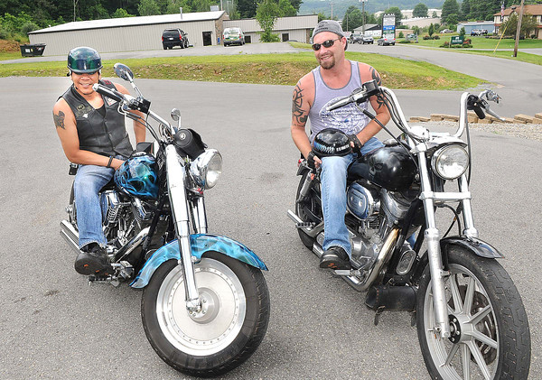 Angel Santos, of Beckley, left, and Brett Dillon, of Oak Hill, will be riding in the Living Waters Poker Run and Fundraiser.<br /> Rick Barbero/The Register-Herald