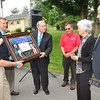 Beckley Sanitary Board held a groundbreaking ceremony for the Thomas H. Keyser Memorial Rain Garden in the triangle at the intersection of Tolley & Holliday Drive and Painter Street in Maxwell Hill. From left, Wayne Davis, board member, Jeremiah Johnson, general manager, Beckley mayor, Emmett Pugh and John Peplowshi, operation manager, presented a plaque to Pam Keyser, widow of Tom Keyser and John Keyser, son of Tom Keyser. <br /> Rick Barbero/The Register-Herald