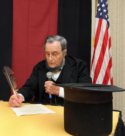 Jim Rubin A.K.A. Abraham Lincoln reinacts the signing of West Virginia into statehood during the satae's Birthday celebration at Tamarack on Thursday. F. Brian Ferguson/The Register-Herald