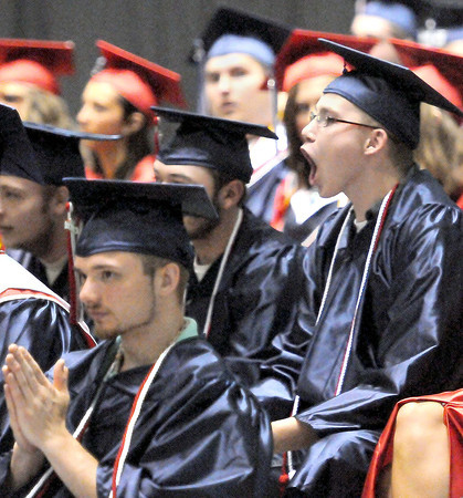 Independence High School students cheet on their fellow graduates before graduation at the Beckley-Raleigh County Convention Center. F. Brian Ferguson/The Register-Herald