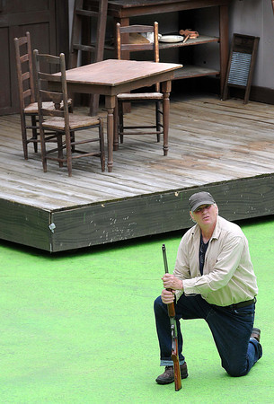 Andy Woodruff, as Devil Anse Hatfield, rehearses at Grandview State Park for the Hatfield's and McCoys's musical.<br /> Rick Barbero/The Register-Herald