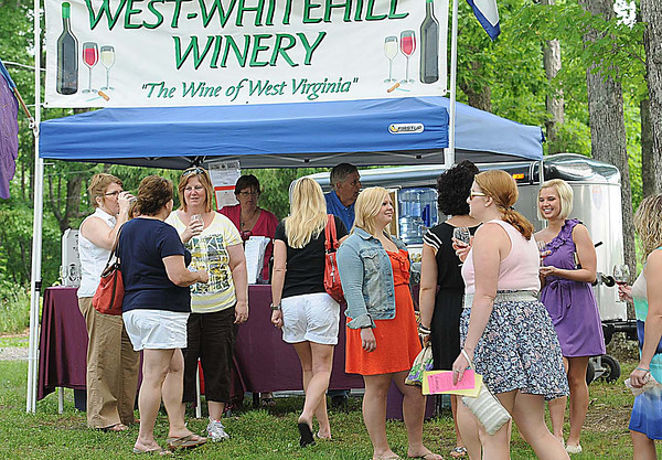 People enjoying the wine tasting during the 15th annual West Virginia Spring Wine Festival at Daniel Vineyards in Crab Orchard.<br /> Rick Barbero/The Register-Herald