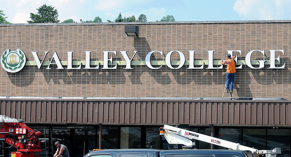 Valley College gets it's sign installed on Friday as workers put on the finishing touch F. Brian Ferguson/The Register-Herald