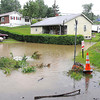 Jerry Fox looks over the water in his front yard on Ewart Ave. in Beckley Tuesday morning.<br /> Rick Barbero/The Register-Herald