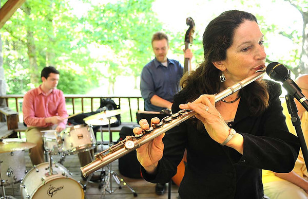 Margaret Holz playing the flute for Doc Greenberg's Patient Jazz Band during the 15th annual West Virginia Spring Wine Festival at Daniel Vineyards in Crab Orchard.<br /> Rick Barbero/The Register-Herald