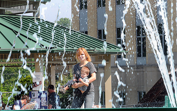 Belinda Farley and Conner Moliere of Pax enjoy the fountain at Word Menorial Park in Beckley during Saturday's Raleigh County Right to Life annual Walk of Life. F. Brian Ferguson/The Register-Herald