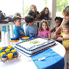 Leslie Baker, director Youth Museum & Exhibition Coal Mine and her grand daughter, Londen Baker, 4, cut the cake for WV 150th birthday. Kids from the Youth Museum Art Camp watch in the background.<br /> Rick Barbero/The Register-Herald
