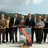 The official Ribbon cutting for the kick-off of the New River Parkway in Hinton was attended by Congressman Nick Rahall, center, Tom Smith of the Department of Federal Highways, left, and Paul Mattox, Secretary of Transportation, right, among others. The Parkway will connect Hinton with I-64, along the New River. F. Brian Ferguson/The Register-Herald