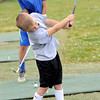 Jackson Williams, 6, front, and his brother Tommy Williams, 11, rear, both of Beckley, give it their all on Saturday during the First Tee of West Virginia's day at Brier Patch Golf Links. F. Brian Ferguson/The Register-Herald