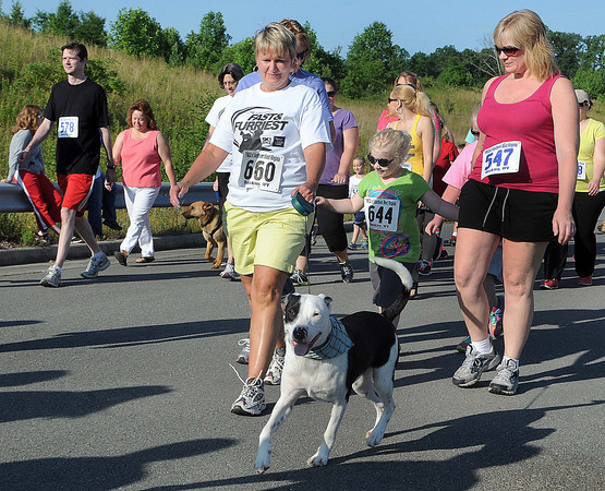 """""""The Fast and the Furriest"""" 5K Run/One Mile Walk got underway on Saturday morning as runners with both two and four legs started at the Paul Cline Memorial Sports Complex. F. Brian Ferguson/The Register-Herald"""