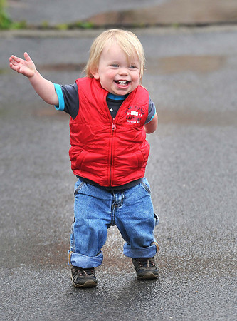 Gabriel Muncuso, 20 months, son of Steve and Katrina Muncuso, of Fayetteville, waves to his parents in the parking lot of Musical Grounds Coffee Shop in Fayetteville.<br /> Rick Barbero/The Registewr-Herald