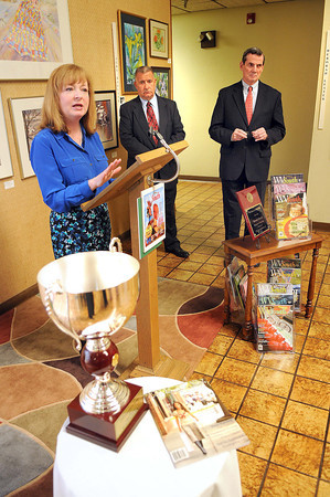 Community Newspaper Holdings Inc. President and CEO Donna Barrett. left, Beckley Newspapers Publisher, Frank Wood and CNHI Senior VP for News William Ketter, speak during the WV South awards brunch in the lobby of Beckley Newspapers.<br /> Rick Barbero/The Register-Herald