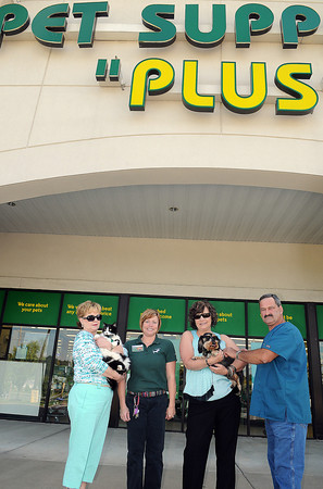 """(From left), Peggy Prater holding """"Tink,"""" Monica Richards, Karen Mays holding """"Charlie,"""" and Vet. Asst. Robert Howerton at Pet Supply Plus in the Cranberry Plaza. F. Brian Ferguson/The Register-Herald"""