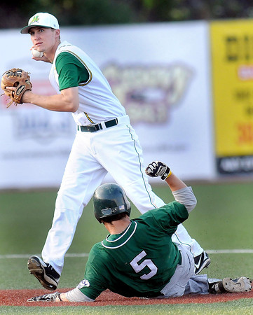 West Virginia Miners Shortstop #3 turns a double play as SR #5 slides into second Tuesday evening. F. Brian Ferguson/The Register-Herald
