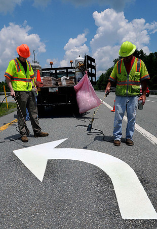 Scouting for the Scouts=Employees of Roadsafe from Nitro Ben Thompson, left, and Butch Oliver, right, restripe a turn arrow on Rt. 19 North between Glen Jean and Oak Hill in preperation for the Boy Scouts arrival in July.  F. Brian Ferguson/The Register-Herald