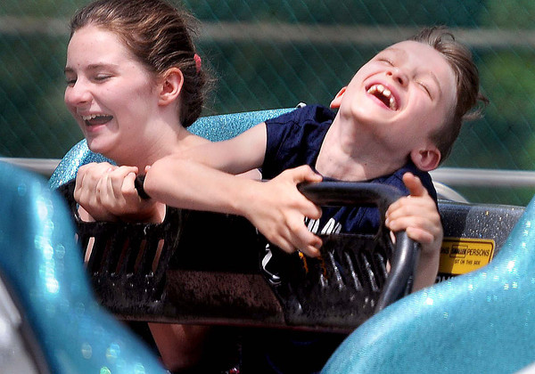 Aimee Massey, 11, left, and her brother Tyler Massey, 8, both of Horse Creek, enjoy the rides during Saturday's Beach Blast at Lake Stevens. F. Brian Ferguson/The Register-Herald